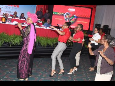 Marcia Griffiths (left), international reggae songbird, had JMMB Group team members and shareholders dancing to one of her classics, 'Electric Boogie'
