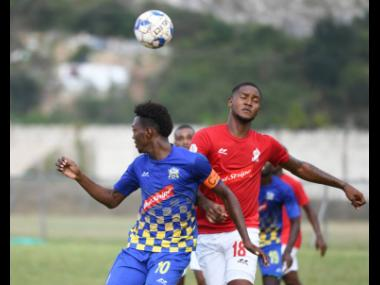 Molynes United's Nicholas Nelson (left) goes up for a header with UWI's Sheldon McKoy in their Red Stripe Premier League encounter at the UWI Mona Bowl on Sunday, January 26, 2020.