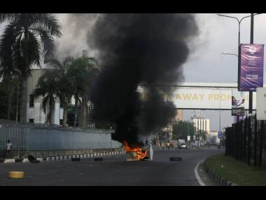 Burning barricades set by protesters against police brutality in Lagos, Nigeria, on Wednesday