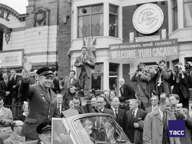 Soviet astronaut Yuri Gagarin (left front) is greeted by a jubilant crowd as his motorcade passes through London, in July 1961.