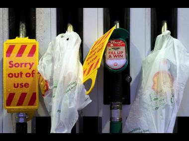 Closed pumps are seen on the forecourt of a petrol station in Manchester, England, on Monday, September 27. The petrol station was one of many across the UK which ran out of fuel after an outbreak of panic buying. AP