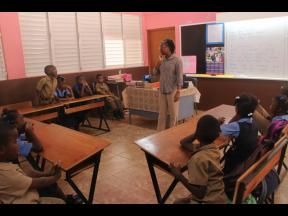 Nordia Anderson- Wallace, teacher, Campbell's Castle Primary School interacts with students.