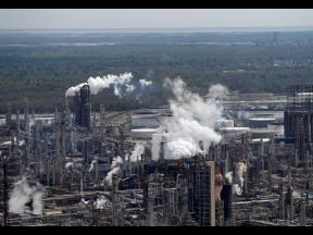 In this March 8, 2018 file photo, wetlands are seen beyond the Shell Norco refinery in Norco, La. The world may be heading into an oversupply of oil, and that possibility is hanging over members of the OPEC cartel.