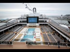 This June 3, 2017 file photo shows the upper deck pool area of the MSC Meraviglia cruise ship docked in Le Havre harbour, Normandy, France. The cruise ship was turned away in February  2020 by two nations, Grand Cayman and Jamaica, after it reported one crew member from the Philippines was sick with common seasonal flu, and was being allowed to dock at Mexico's Caribbean island of Cozumel and passengers would be allowed to disembark, President Andrés Manuel López Obrador said Thursday.