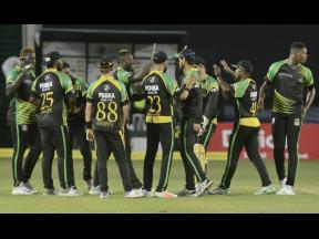 Jamaica Tallawahs players celebrate the fall of a St Lucia wicket in Match 7 of the Hero Caribbean Premier League at Sabina Park in August 2018.