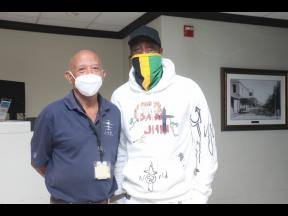 Edward Foster (left), manager, IAM Jet Centre, and Dwyane Wade share lens time on his way off the island after spending his birthday at the exclusive Roaring Pavillion Villa in St Ann.