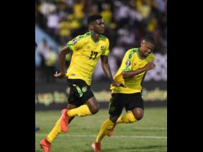 Jamaica's Damion Lowe and Leon Bailey celebrate a goal against Honduras during their Concacaf Gold Cup match at the National Stadium in Kingston on Monday, June 17, 2019.