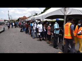 People waiting to receive the coronavirus vaccine at the Ministry of Health and Wellness' mobile vaccination drive at Sovereign Centre in St Andrew last month.