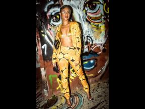 Recording artiste, Naomi Cowan, was ready for the paparazzi as she strutted her stuff in a golden bikini and pantsuit by New York City designer Samantha Black of SammyB Designs.