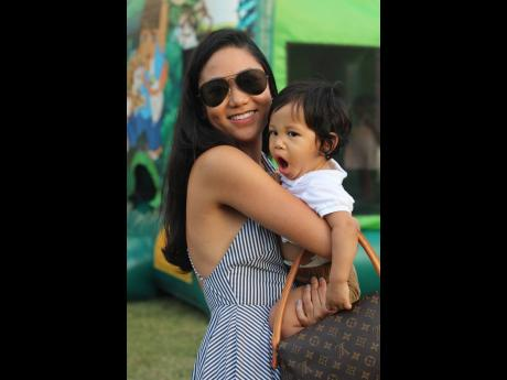 Alyssa Chin, an Attorney-at-law at Myers, Fletcher and Gordon, enjoys a moment with her nephew Brett Fong Yee, in the play area.
