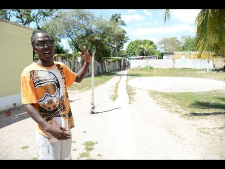 Ian Allen/Photographer Jevanti Harris, a resident of Rose Town in Kingston, who wants to see greater youth outreach in his community.