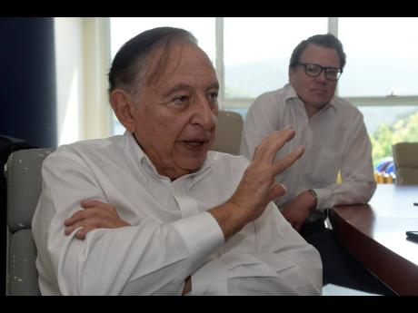 Lionel Rookwood/Photographer Professor Robert Gallo makes a point during an interview with The Sunday Gleaner. In the background is Joshua Anzinger.