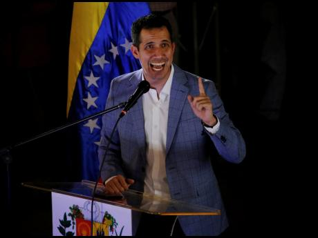 National Assembly President Juan Guaidó delivers a speech during a meeting with residents in the Hatillo municipality of Caracas, Venezuela, on Thursday, March 14.