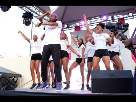 Machel Montano and his dancers were flying high at 'The Caribbean Identity' campaign launch at the Caribbean Airlines Kingston Ticket office last Friday.
