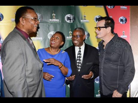 From left: Reggae historian Copeland Forbes; Minister of Culture, Gender, Entertainment and Sport Olivia Grange; Ephraim Martin, president of Martin's International; and Josef Bogdanovich in a very animated conversation at Tuesday's media launch of  IRAWA 2019.