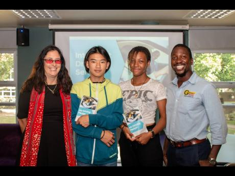 From left: Melanie Kells, principal of AISK; grade-eight students Yanhua Liang and Nikole Okonmah; and Seth Grennell, senior driving instructor, Grennell's Driving School.