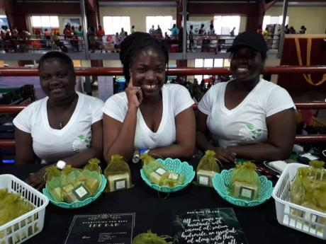 The Bar consists of an all female team who are a part of the handmade process from the beginning to the end. Seated at the Women's Expo within the Wolmer's Boy's Auditorium are Jada, Roejan and Pat.