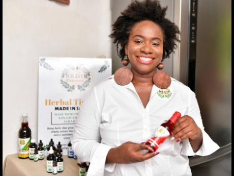 Owner of Holistic Paradise, Nastassia Grant, shows off one of her products on April 15, 2019.