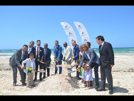Photo by Albert Ferguson  Prime Minister Andrew Holness (centre, blue suit), other Jamaican officials and officials of Amaterra Group participate in the groundbreaking ceremony for the 8,000-room resort on Friday, April 12.