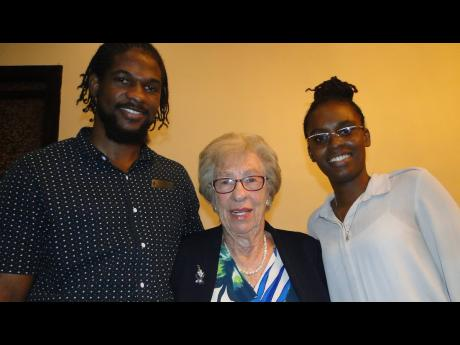 Eighty-nine-year-old Holocaust survivor Eva Schloss is sandwiched by Kyle Schloss, second-year UWI MSc clinical psychology student, and Ron-Di Lacey of Paperboy Jamaica on April 2 at The Jamaica Pegasus hotel in St Andrew.