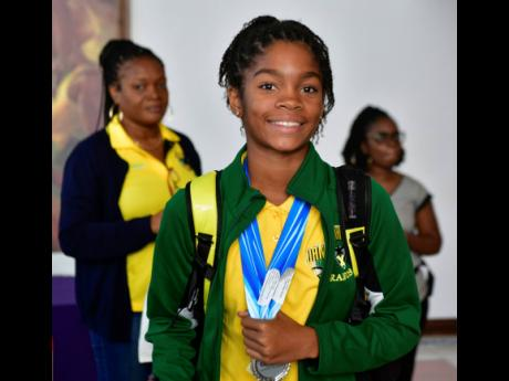 Giani Francis proudly display medals won at the 2019 Carifta Swimming  Championship held in Barbados over the Easter weekend. Francis, one of 31 swimmers of the Jamaican contingent returned to Jamaica at the Norman Manley International Airport (NMIA) on Wednesday, April 23, 2019.