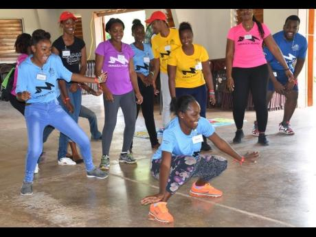 Students and facilitators participate in a Jamaica Moves training session to become ambassadors for healthier lifestyle in schools.