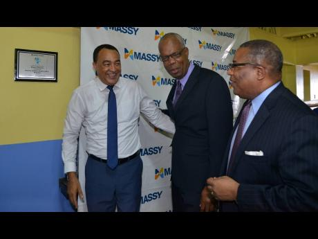 Minister of Health Dr Christopher Tufton (left); Peter Graham, country manager for Massy Jamaica; and Member of Parliament Anthony Hylton are all smiles at the Ministry of Health's Adopt-a-Clinic ceremony at the Seaview Gardens Health Centre in St Andrew on Tuesday.