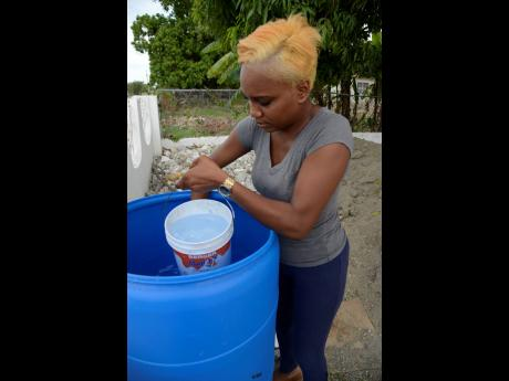 Kimberly Cummings, a resident of Albion in St Thomas, is down to her last drum of water.