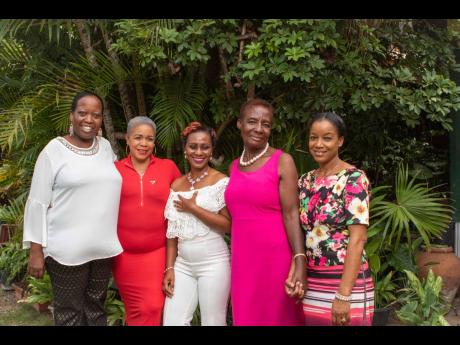Cancer survivors Nioca Irving Simpson (second left), Ann-Marie Gordon (centre) and Norma Reid (second right), are all smiles during a Pre-Mother's Day brunch held in their honour at the Alambra Inn, recently by the Insurance Company of the West Indies (ICWI). With them are ICWI Road Angel policy holders Shullian Brown (left) and Andrea Graham-Simmonds (right).