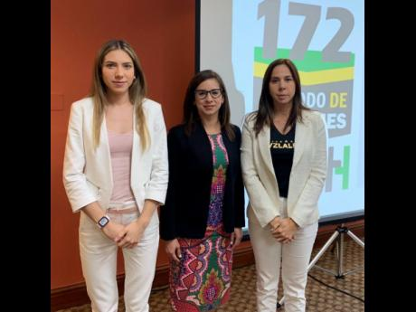 Fabiana Rosales (left) is seen with unidentified officials of the Inter-American Commission on Human Rights.