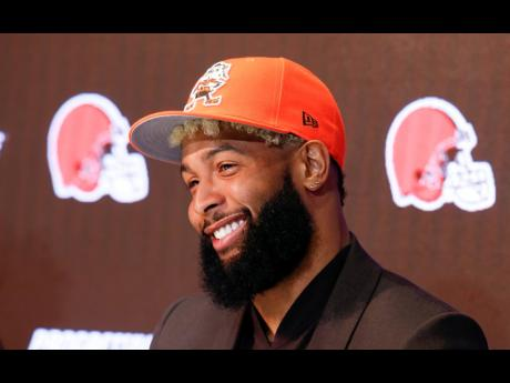 In this April 1, 2019, file photo, Cleveland Browns' Odell Beckham answers Jr questions during an NFL news conference in Berea, Ohio. The star wide receiver reported to the team's headquarters Monday and was on the field yesterday for practice.
