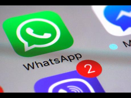 This March 10, 2017 file photo shows the WhatsApp communications app on a smartphone in New York. WhatsApp says a vulnerability in its  app let mobile phones be infected with sophisticated spyware with a missed in-app call alone.