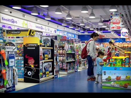 Customers shop at a toy store in Beijing, Wednesday, May 15, 2019.