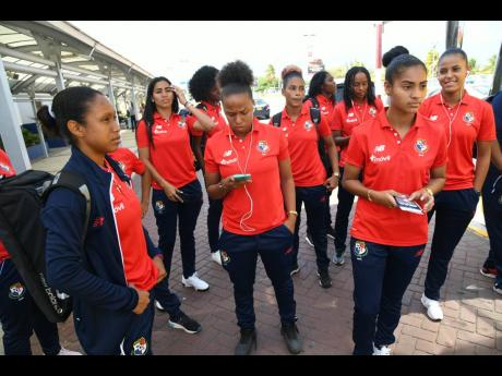 Panama's senior women's football team on arrival at the Norman Manley International Airport yesterday ahead of tomorrow's international friendly against Jamaica at the National Stadium tomorrow.