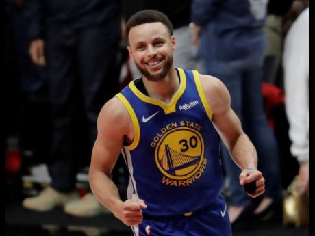 Golden State Warriors guard Stephen Curry reacts at the end of Game 4 of the NBA basketball play-offs Western Conference finals against the Portland Trail Blazers on Monday, May 20, 2019, in Portland, Ore. The Warriors won 119-117 in overtime.