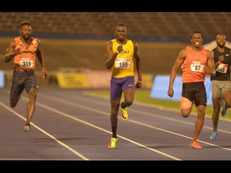 Jahnoy Thompson (centre) winning the men 200m ahead of Nigel Ellis (right) and Rasheed Dwyer (left) at the JAAA/SVL National Senior Championships in 2018.