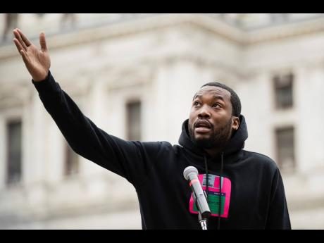 Meek Mill speaks at a gathering to push for drastic changes to Pennsylvania's probation system in Philadelphia. Mill has become a symbol for reform after a judge in Pennsylvania sentenced him to two to four years in prison for minor violations of his probation in a decade-old gun and drug-possession case.