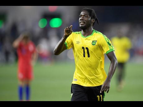 Jamaica forward Shamar Nicholson (11) celebrates his goal during the second half of the team's international friendly  match against the United States yesterday in Washington. Jamaica won 1-0.