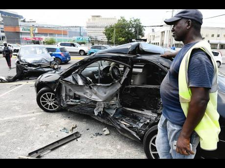 In this April 2018 file photo, a Volkswagen SUV and a Honda motor car collided on Trafalgar Road in Kingston.