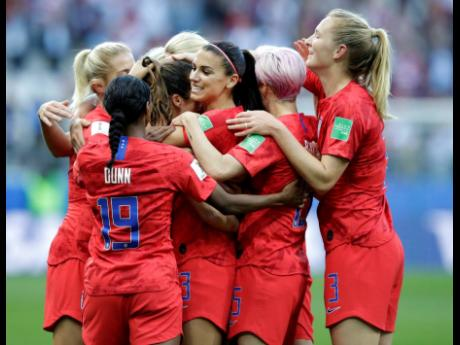 United States' Alex Morgan (centre) celebrates after scoring the opening goal during their 13-0 rout of Thailand in Group F of the FIFA Women's World Cup at the Stade Auguste-Delaune in Reims, France, yesterday.