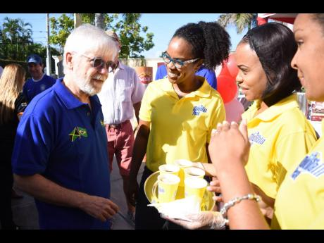Brazilian Ambassador to Jamaica, His Excellency Carlos Alberto M. den Hartog (left), greets commercial and corporate affairs manager at Salada Foods, Tamii Brown (second left) before sampling the LASCO-distributed Mountain Peak Instant Coffee. Looking on are: Sherianne Hart (right), Salada Brand Manager at LASCO Distributors, and Ariel Thomas, brand ambassador.
