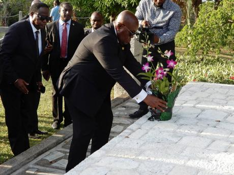 President of Ghana, Nana Akufo-Addo, lays a floral tribute at the shrine of three African slaves at Seville Great House and Heritage Park in St Ann on Saturday.
