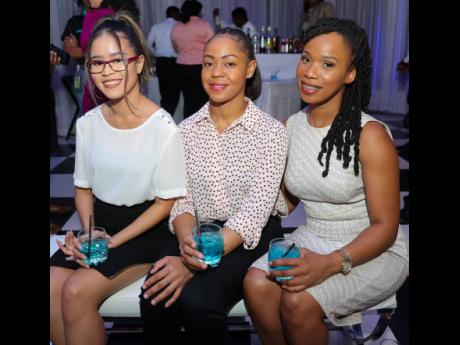(From left) Stacy-Ann Russell, Terice Blake and Gabriella James, of insurance brokerage firm, Fraser, Fontaine and Kong Limited, take a quick break from the festivities to enjoy a special Sagicor cocktail.