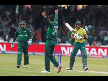 South Africa's Aiden Markram (right) is bowled by Pakistan's Shadab Khan (centre) during their ICC World Cup match at Lord's cricket ground in London, England, yesterday. AP