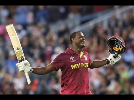 Windies' Carlos Brathwaite celebrates after scoring a century during the ICC World Cup match against New Zealand at Old Trafford in Manchester, England, on Saturday.