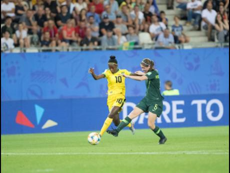 Jamaica's Jody Brown (left) shakes off the challenge of Australia's Karly Roestbakken during their final Group B game of the FIFA Women's World Cup at Stade des Alpes in Grenoble, France, on Tuesday, June 18.