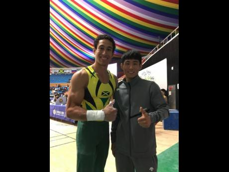 Caleb Faulk (left) and South Korea's first Olympic medallist, Yang Hak-Seon, at the Korea Cup in Jeju, South Korea, last week.