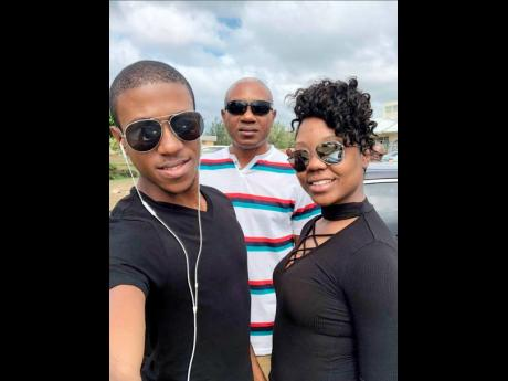 From left: Oraine Frater of L'Acadco shares a frame with his late father, Wayne St Hugh Frater, and his sister, Janielle.