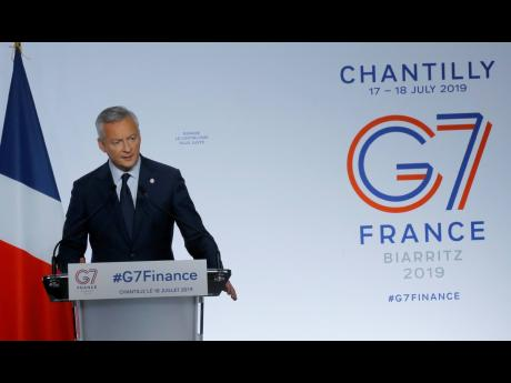 French Finance Minister Bruno Le Maire delivers his speech at the end of the G7 Finance Ministers meeting on Thursday, July 18, in Chantilly, north of Paris.