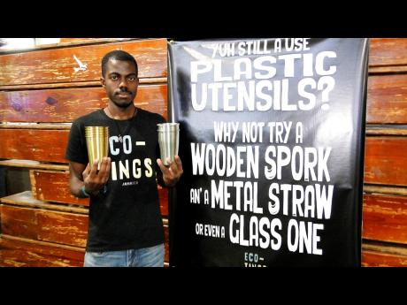 Christoff Johnson of Eco Tings with metal cups sold by the online business.